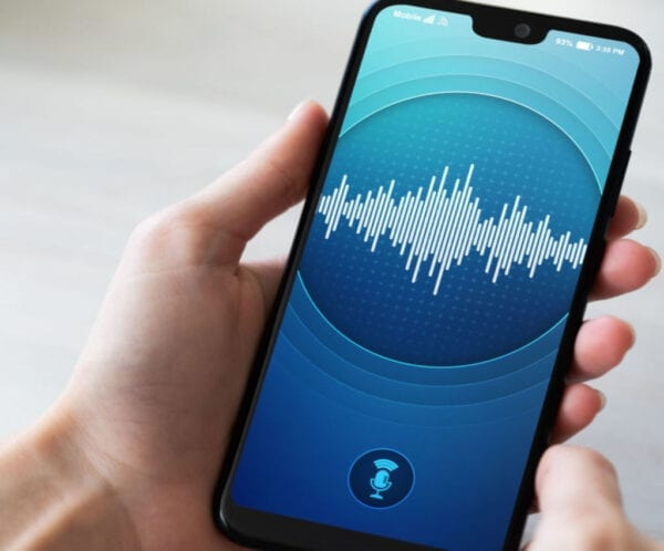 Voice recognition application on smartphone screen. Artificial intelligence and deep learning concept.